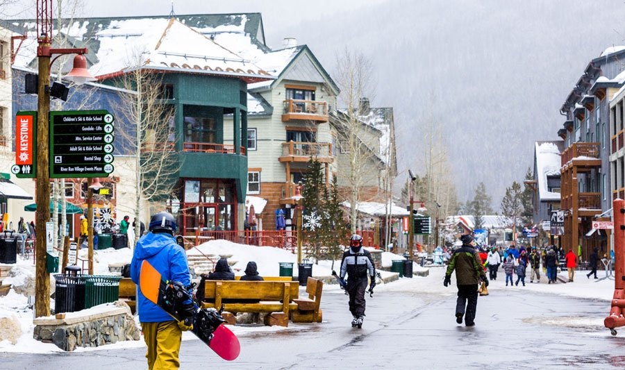 View of people ready for snowboarding in a ski resort