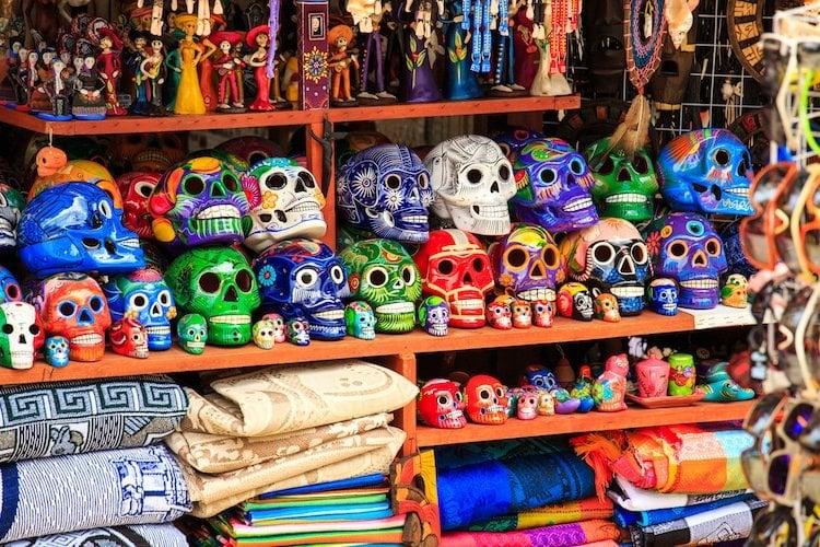 Colorful Dia de los Muertos skulls line the shelves of a playa del carmen shop