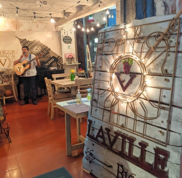 Sign and interior of Laville Bistro Cafe in Valladolid