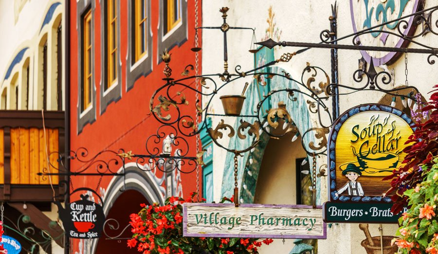 View of some store signage in a small Bavarian styled village