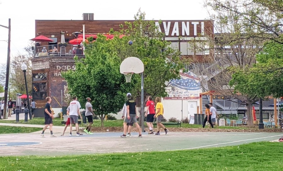 A basketball court in front of Avanti Food and Beverage in the LoHi Denver neighborhood