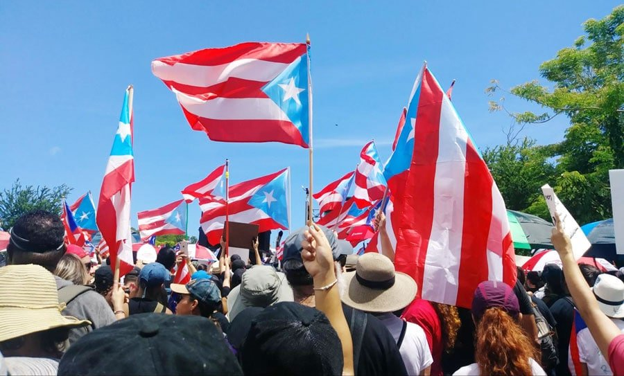 View of locals raising the Puerto Rico flags