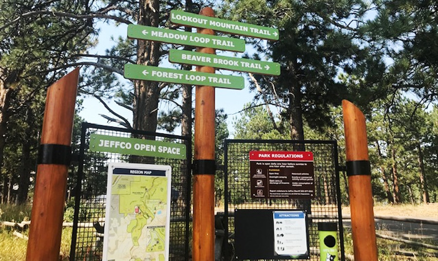 View of signage for different trails in an entrance