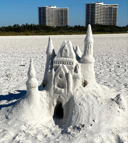 View of a sand castle and two building on the background