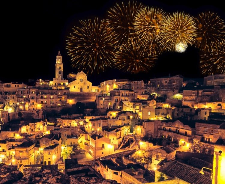 Matera Italy by Night with fireworks over Sasso Barisano