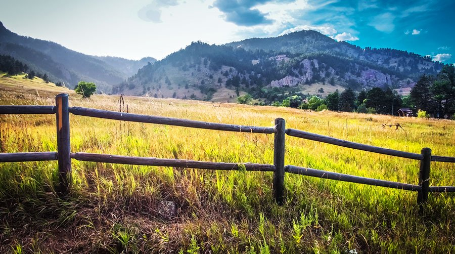 View of Chautauqua Trail from a far and a wooden fence