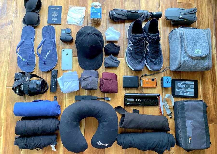 Various items needed for a trip to Mexico spread out on a floor