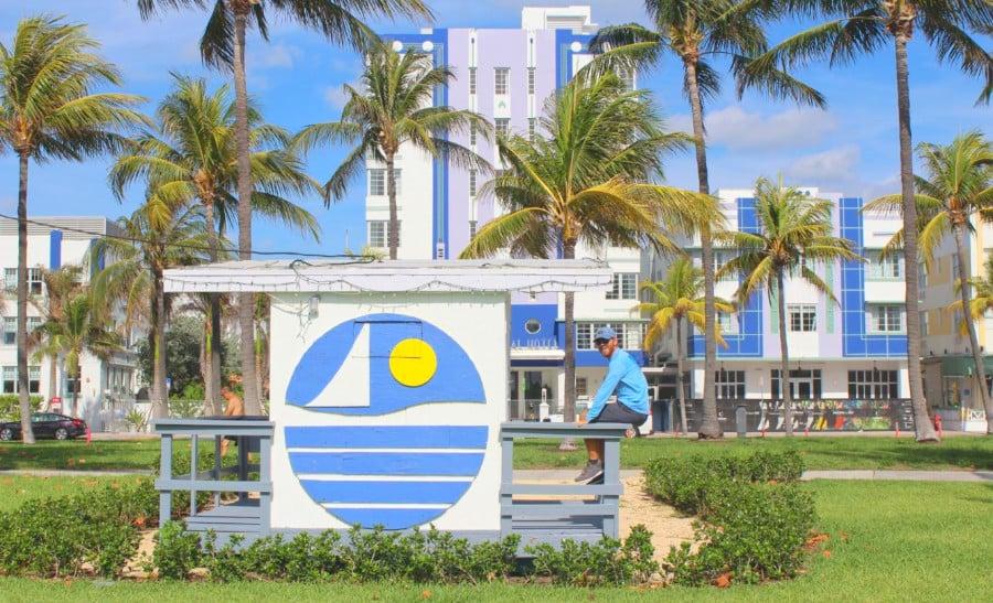 The author sitting on a sign near Miami Beach Florida