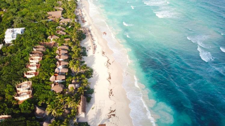 Drone shot of white sand beach in Tulum Mexico