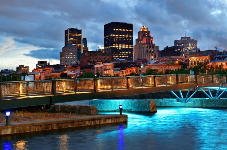 A bridge and cityscape in Montreal, Quebec at dusk