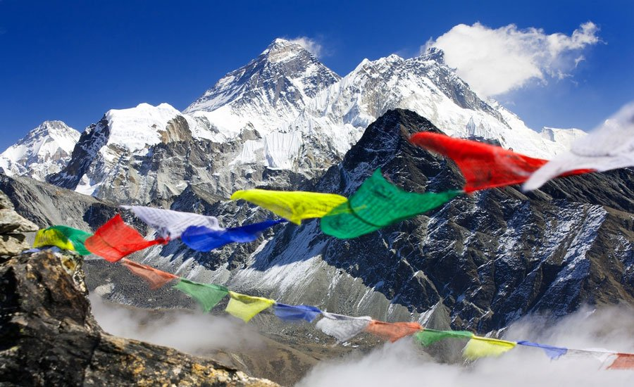 View of the Mount Everest from Nepal and some prayer flags