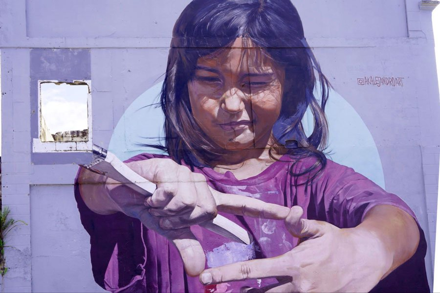 View of a little girl in a street mural