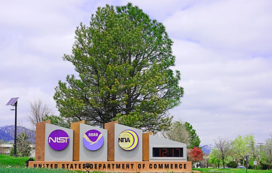 View of the signages in National Oceanic and Atmospheric Administration and a big tree behind it