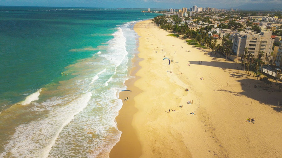 Aerial view of people kiteboarding in Ocean Park Beach
