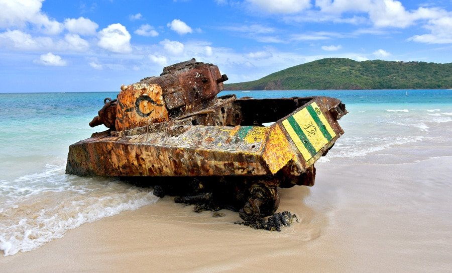 View of the old military tank on Flamenco Beach