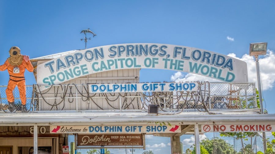 View of the Sponge Capital of the World sign in Tarpon Springs, FL