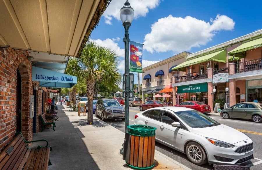 View of cars and shops in downtown Mount Dora, Florida