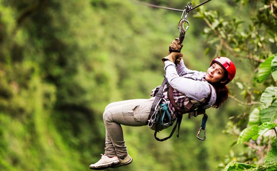 A lady tourist trying out zipline in Castle Rock