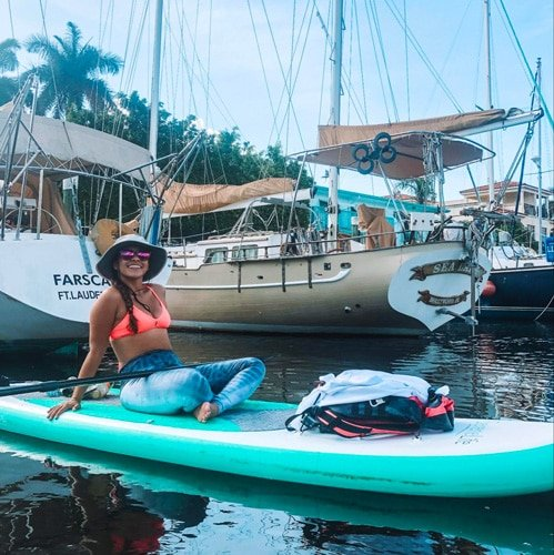 View of the author's wife having fun in paddle boarding
