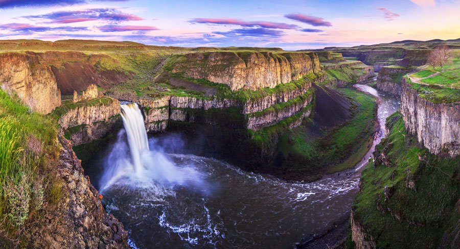 View of the palouse falls and the colorful sky above it