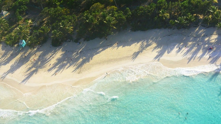 Aerial view of the white sand and blue sea in Playa Flamenco