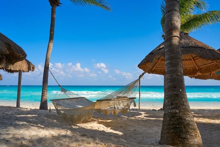 Playa del Carmen beach hammocks and palm trees in Riviera Maya Caribbean at Mayan Mexico
