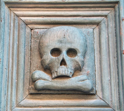 Skull on side of Purgatory Church in Matera, Italy
