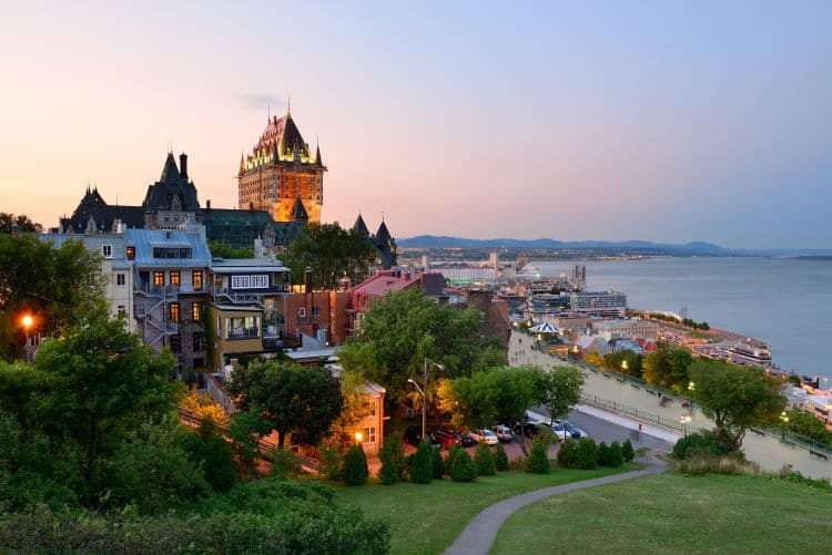 Downtown Quebec City, Quebec at dusk surrounded by water and walking paths