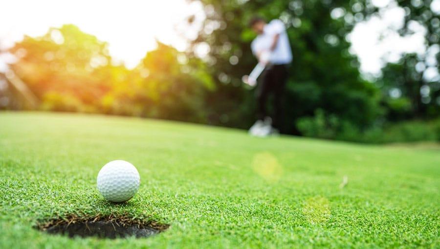Close up view of a golf ball on a grass field