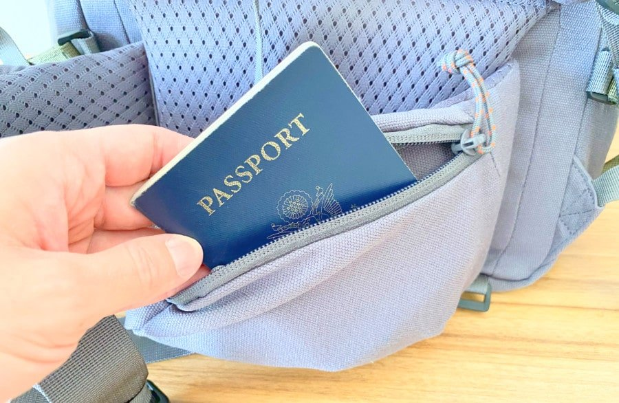 View of a hand inserting a passport into the Salkan hip pocket
