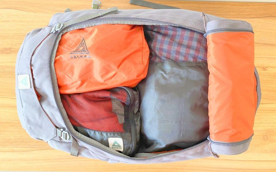 Top view of the Salkan Mainpack travel backpack with clothes and packing cubes inside