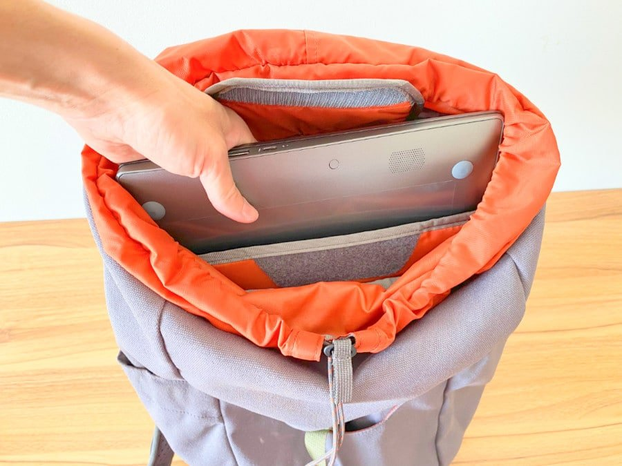 View of a hand inserting a laptop into the Salkan daypack