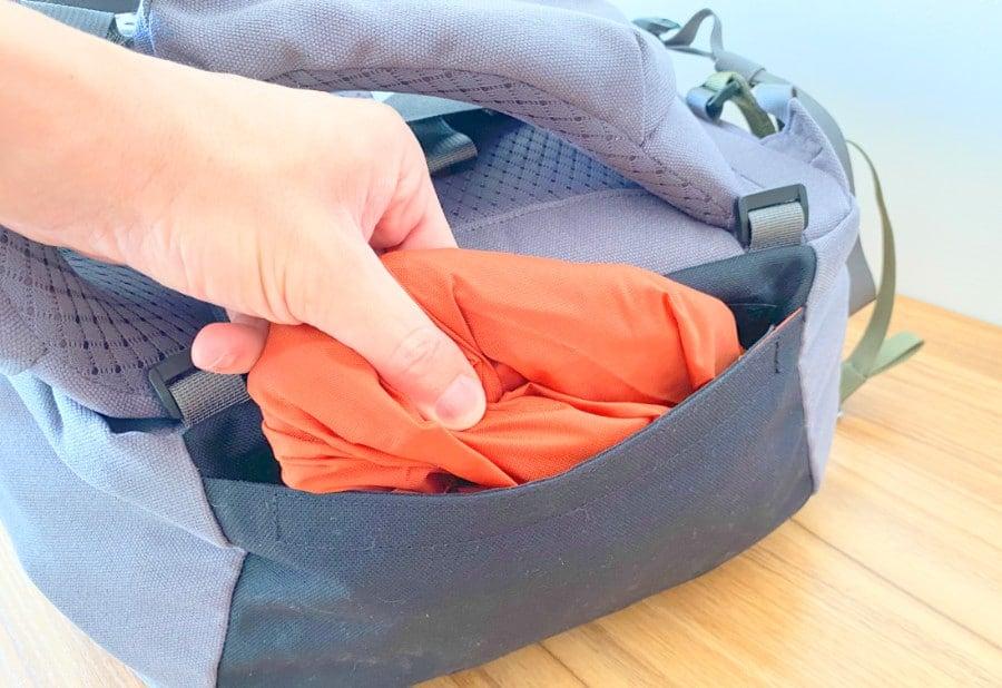 Handing inserting the Flight and Rain cover into the Salkan Mainpack bottom pocket