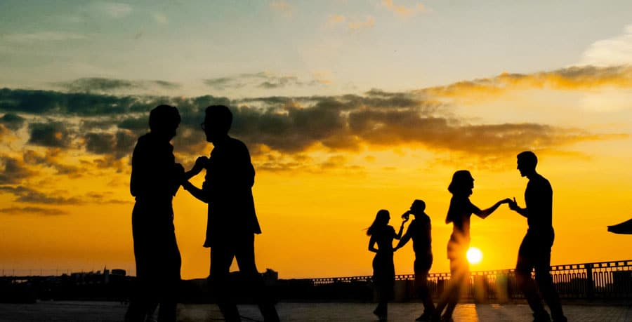 View of people's silhouette dancing during sunset