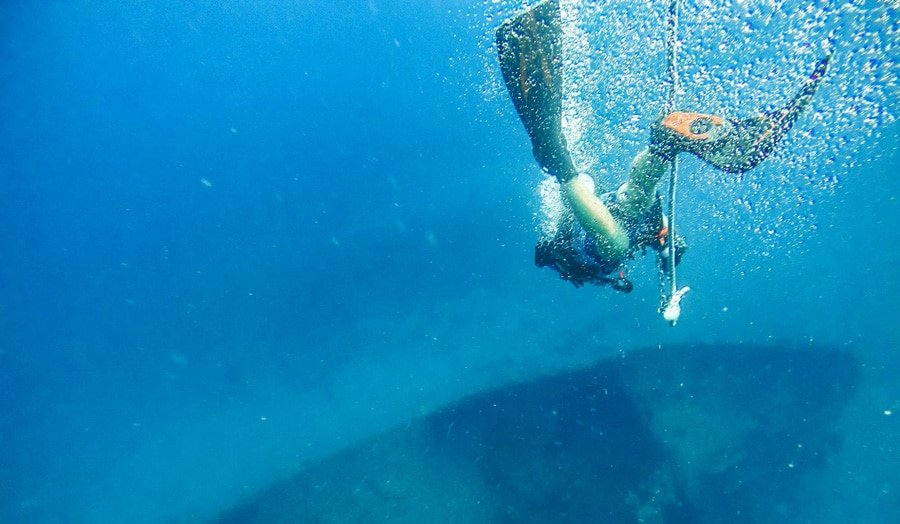View of a scuba diver and the underwater view of Fort Lauderdale