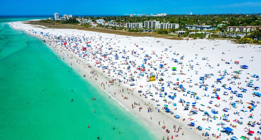 Aerial view of the Siesta Key Beach and the tourists having fun on it
