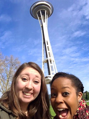 View of the author and her friend with the Space Needle on their background
