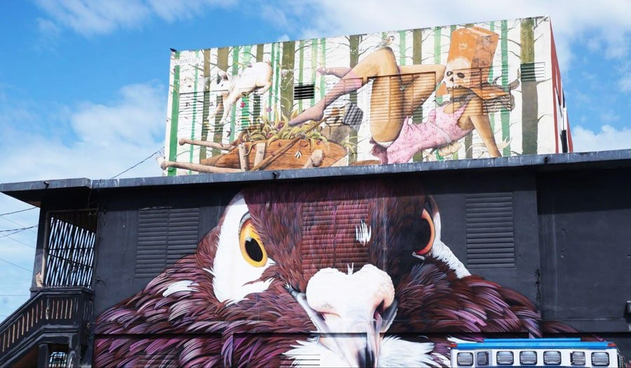 View of an eagle and skull art wall in Santurce