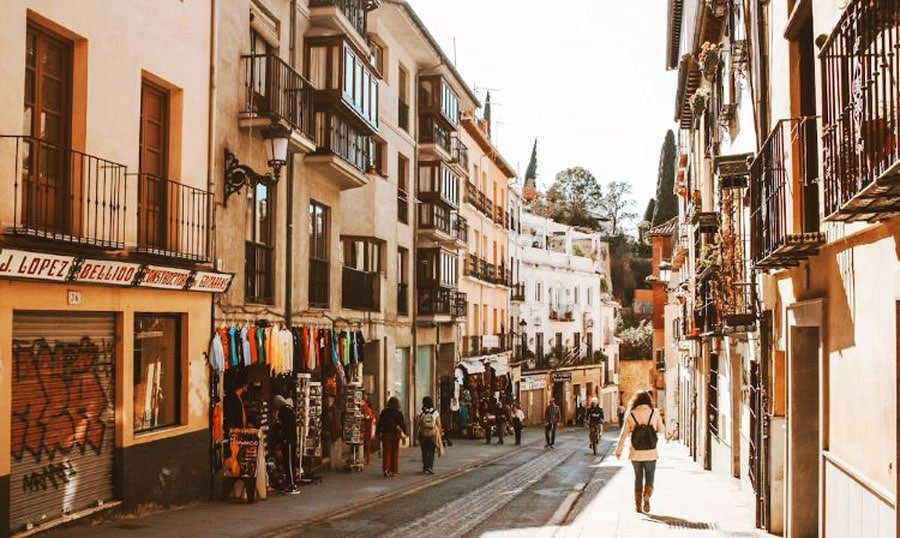 View of an alley and people walking in Granda Spain