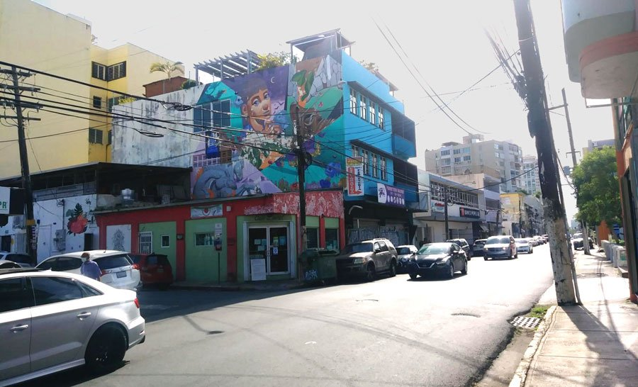 View of cars and a street mural in Puerto Rico