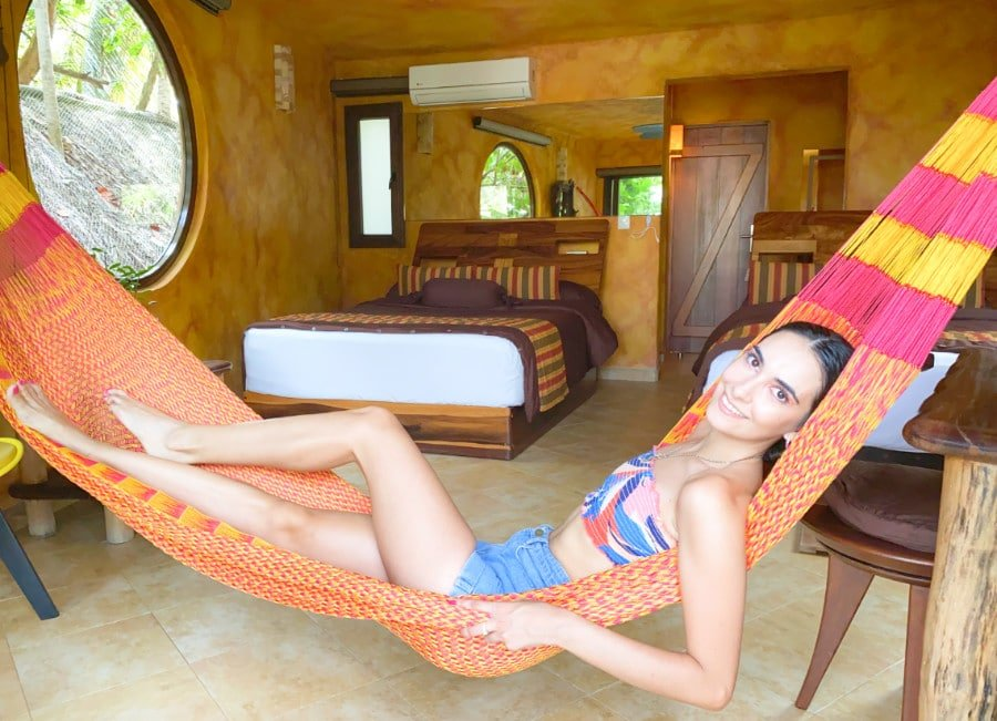 Woman in a hammock at the Suenos Tulum Hotel