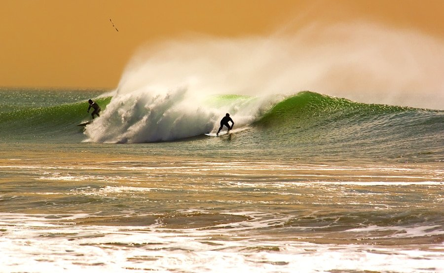 Two surfers having fun at San Clemente State Beach