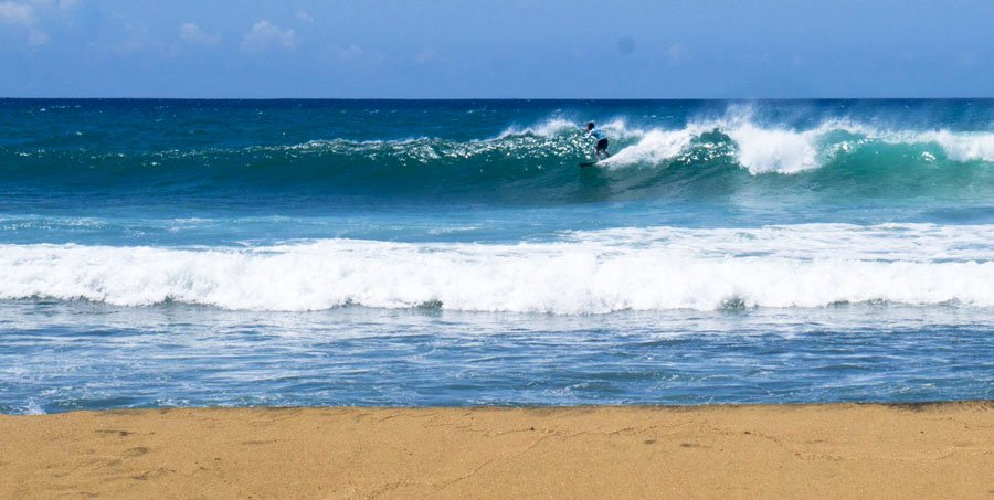 View of man surfing in the Caribbean