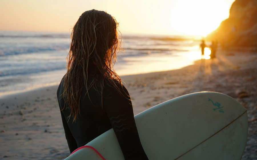 View of a surfer enjoying the sunset in Swami's