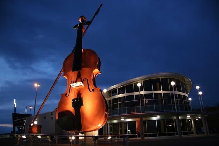 Violin in front of building in Sydney, Cape Breton Nova Scotia