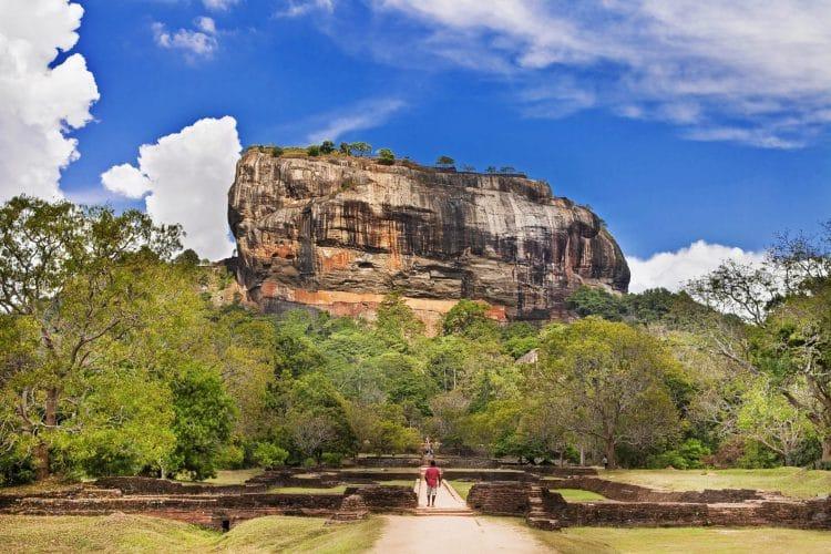 guy standing in front of an ancient landmark Sigiriya Sri Lanka, near Polonnaruwa