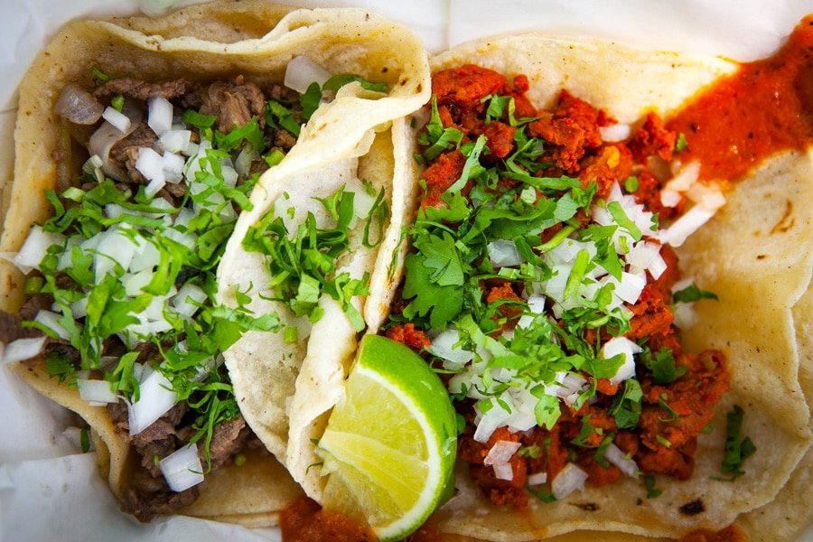 View of a mouthful tacos from Tacos El Papi