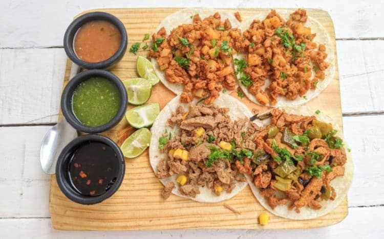 A plate of tacos and salsas