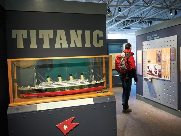 Titanic ship and man looking at picture at the Martime Museum of the Atlantic