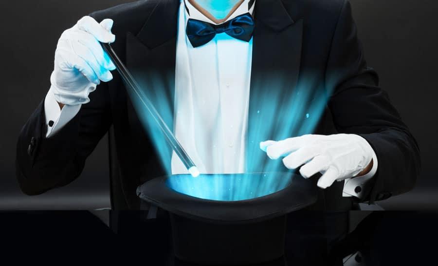 A magician holding a magic wand over a magic hat
